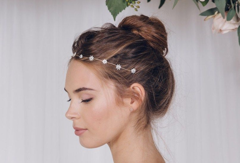 Daisyhttp://www.debbiecarlisle.com/collections/wild-rose-collection-1/products/simple-flower-wedding-headband-in-gold-silver-or-rose-gold-daisy