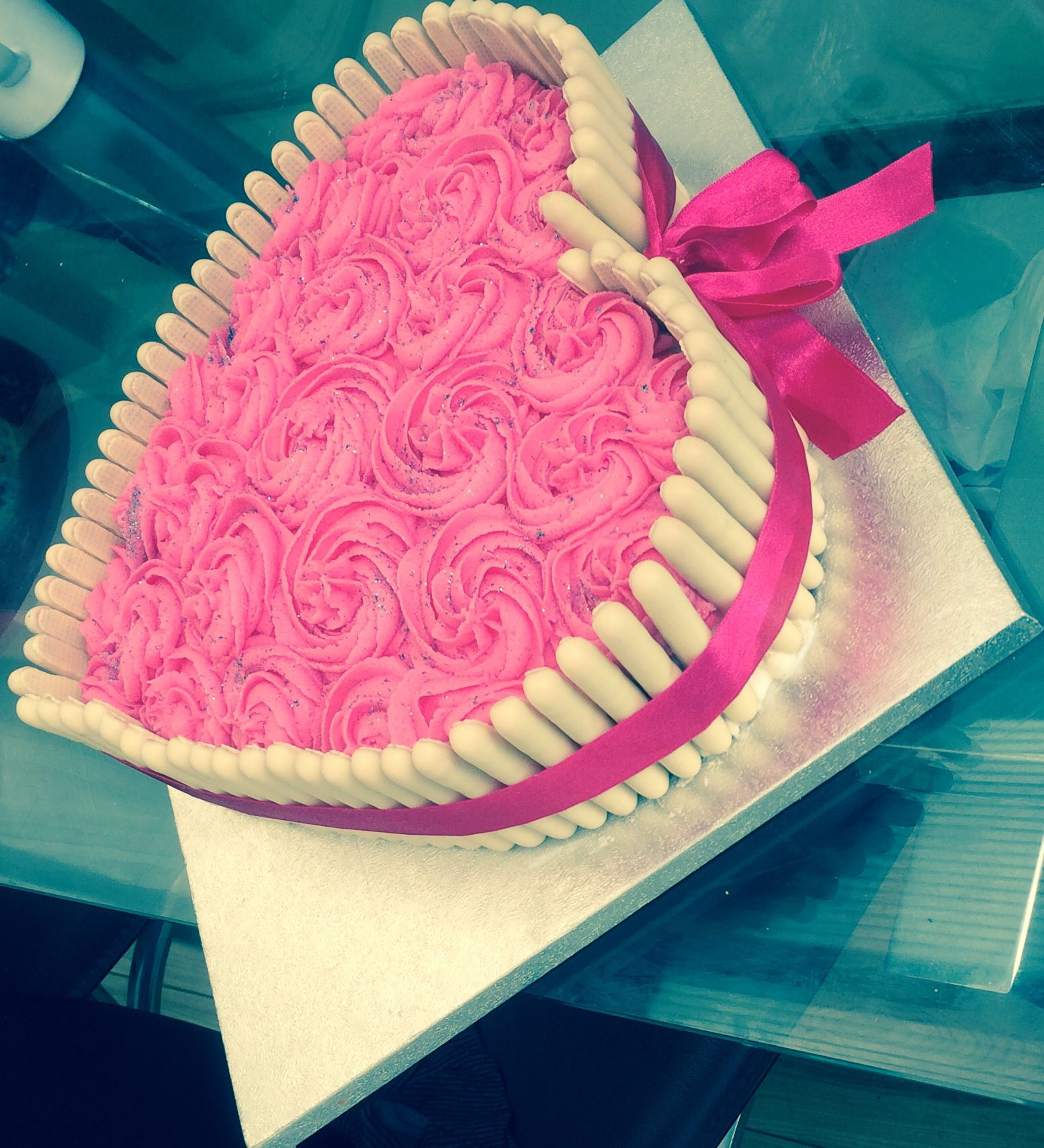 Heart shape white chocolate finger cake and rose swirl ...
