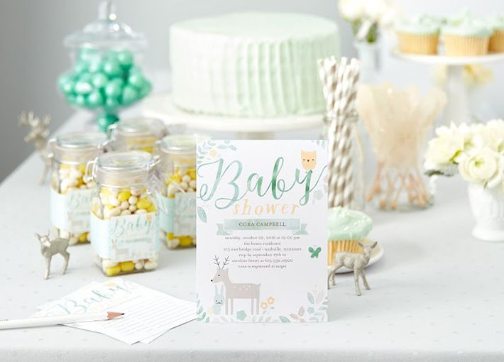 3 wildly fun animal themed baby shower ideas blue cakes shower baby shower invitation in front of pastel blue cake and deer figurines filmwisefo Image collections