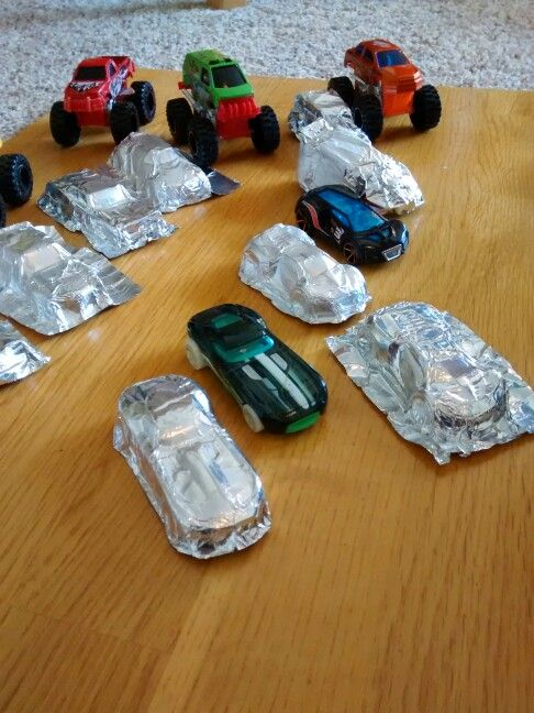 When you cannot go to the monster truck rally, male one at home! Use simplistic toy cars and cover them with aluminum foil, trim excess or leave it. Can reuse the pieces once crushed. Tons of fun!