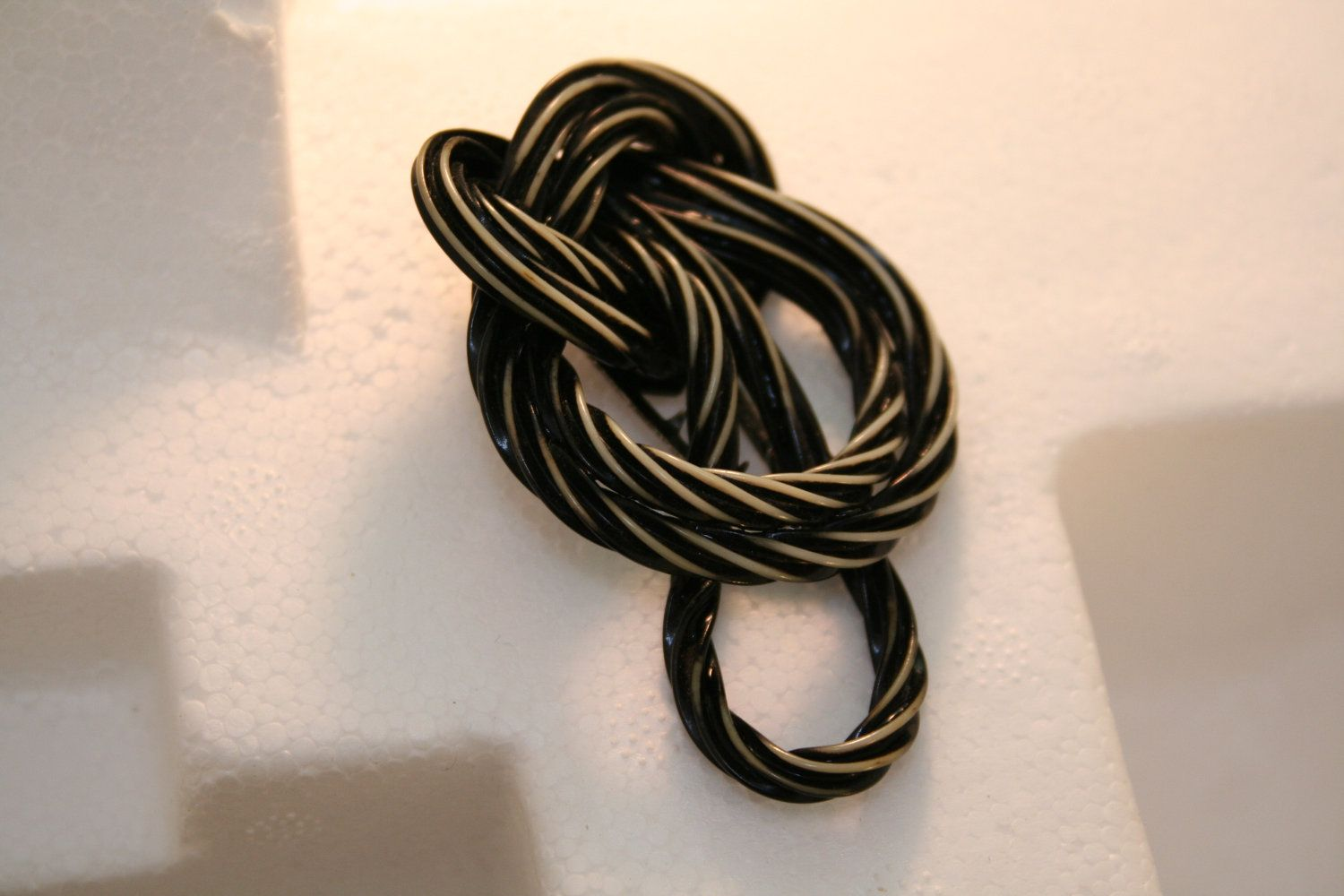 Black and cream licorice brooch. $29.00, via Etsy.