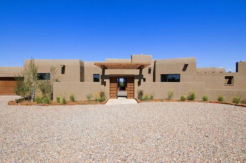 Contemporary santa fe style custom home builders for Adobe home construction