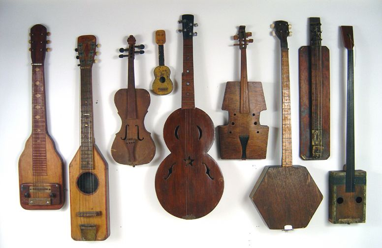 9 antique folk art early American home made musical instruments. Dating from the 1870's to the 1940's. Includes guitars, banjos and violins Lost Found Art