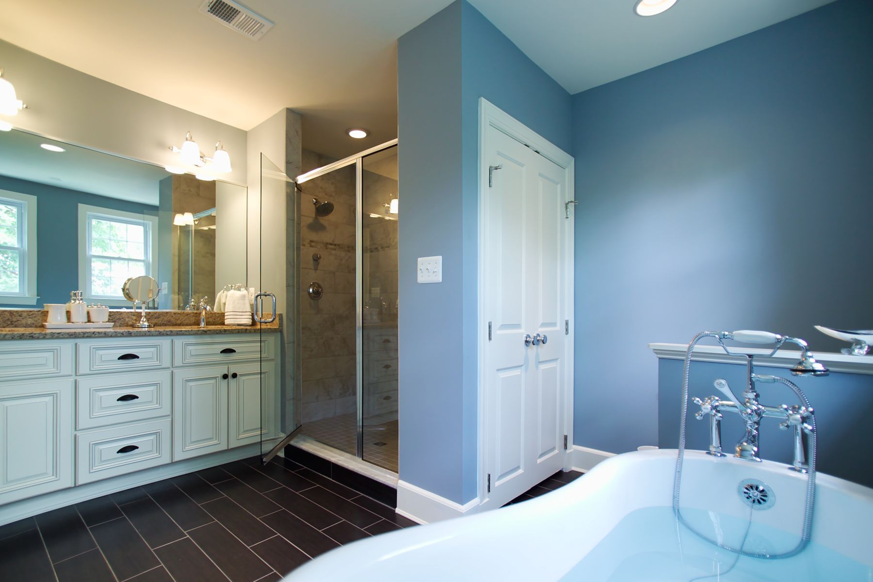Dramatic floor tiles and beautiful wall color make this simple ...