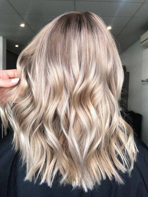 Australian hairstylist Kaitlin Jade shares how she created champagne bronde, a brownish blonde with warm and cool undertones.#