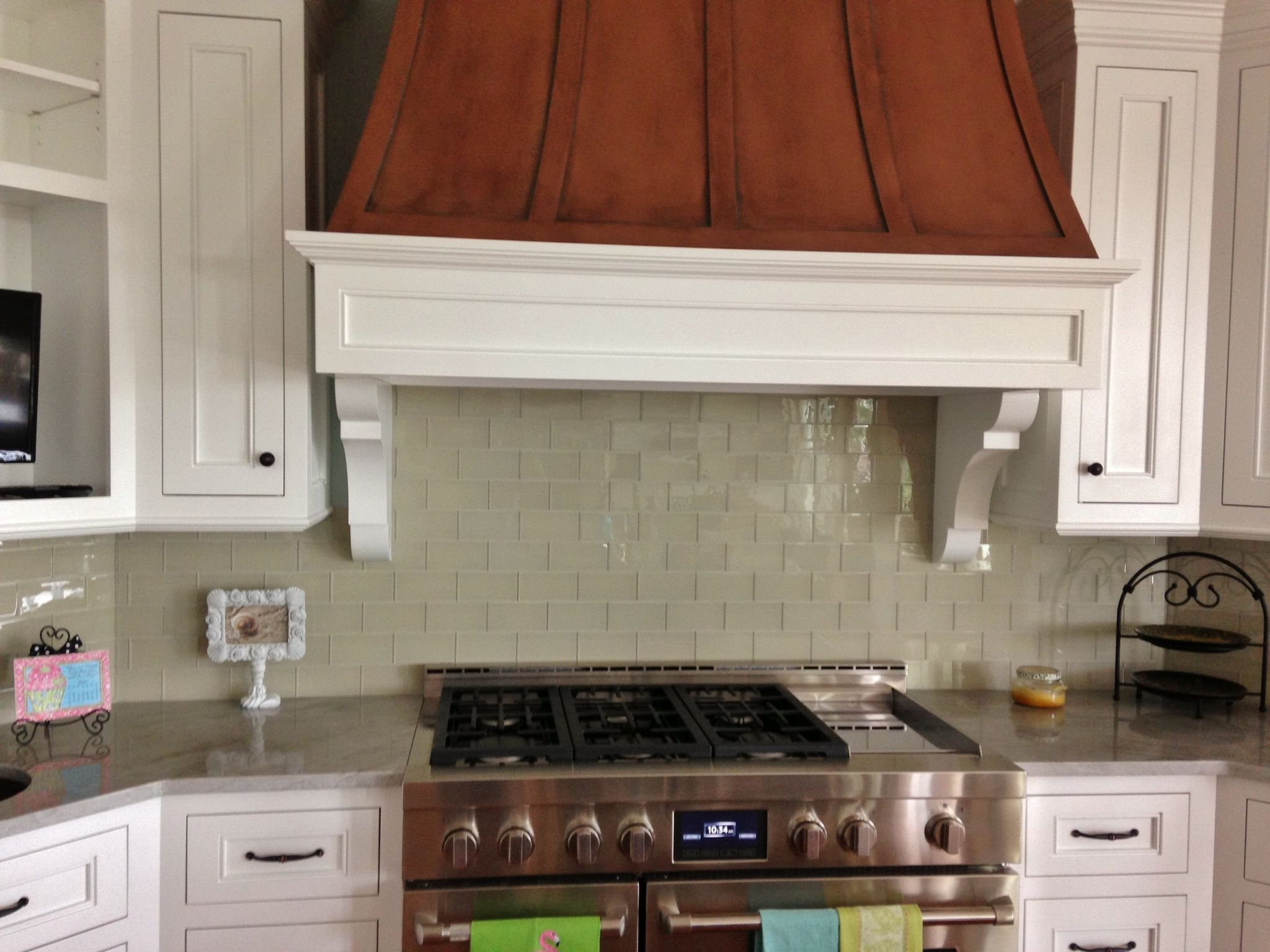3x6 glass subway tiles were used in this kitchen backsplash Simple and modern with no