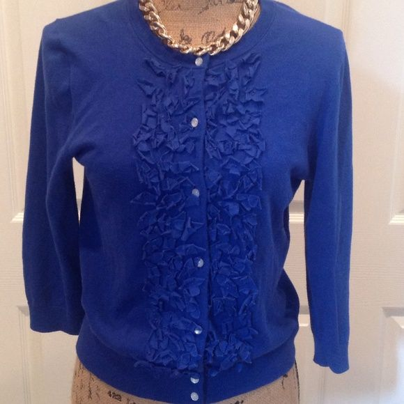Beautiful J Crew Ruffled Cardigan! Adorable J Crew Cardigan.  Ruffle detailing with small beaded trim throughout the ruffles. Three quarter length sleeves. Pearl button front. Pre-loved. Great condition. J. Crew Sweaters