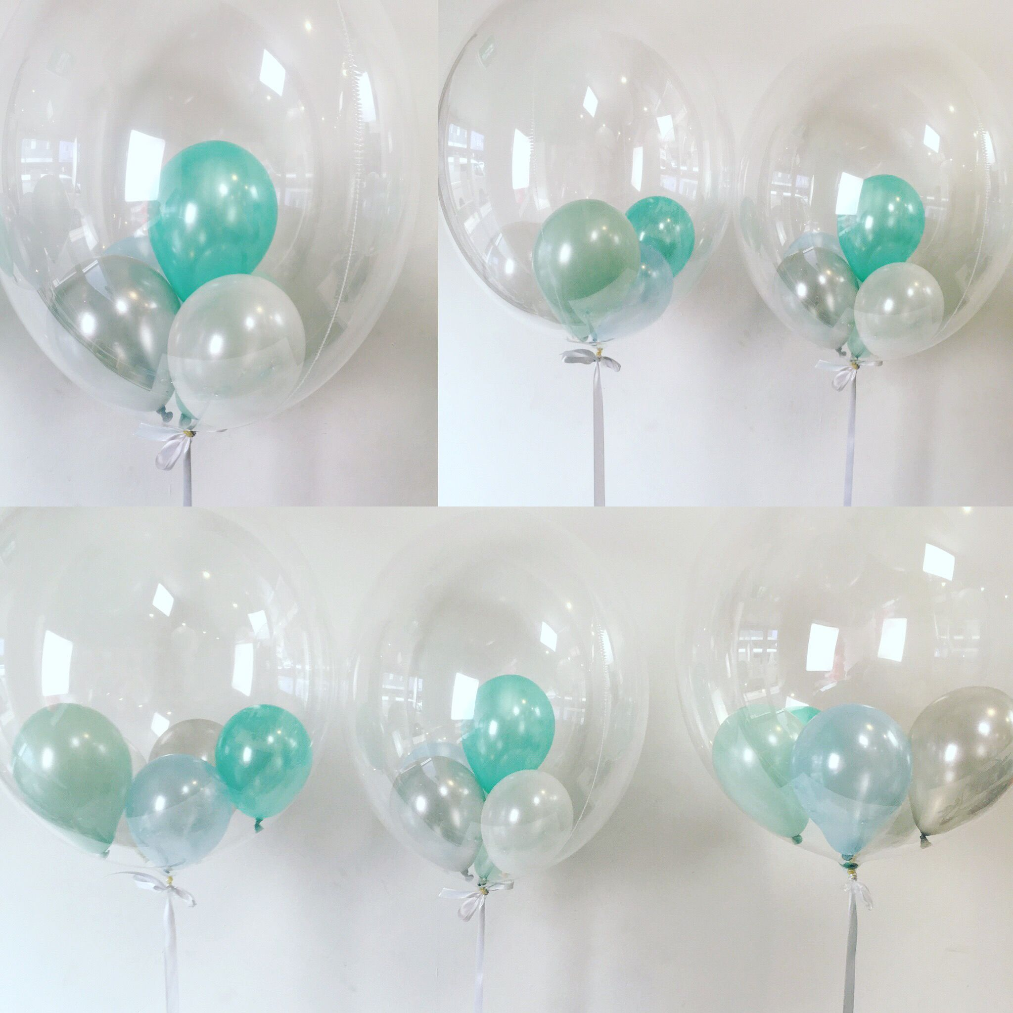 Qualatex clear Deco bubble filled with 5 in mint sea green white