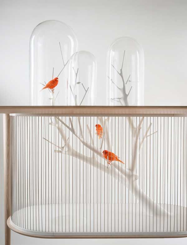 Bird Cage Built Into A Table That Combines Bird-watching with Functionality