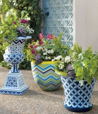 Boost your home's curb appeal with a classic urn transformed by a blue and white hand-painted motif.
