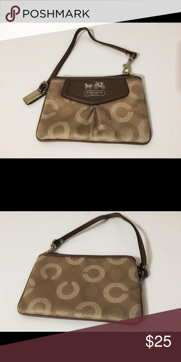 Coach Logo Wristlet This is a coach wristlet decorated with its logo. There is a small pen smudge on the front of the wristlet. Coach Bags Clutches & Wristlets