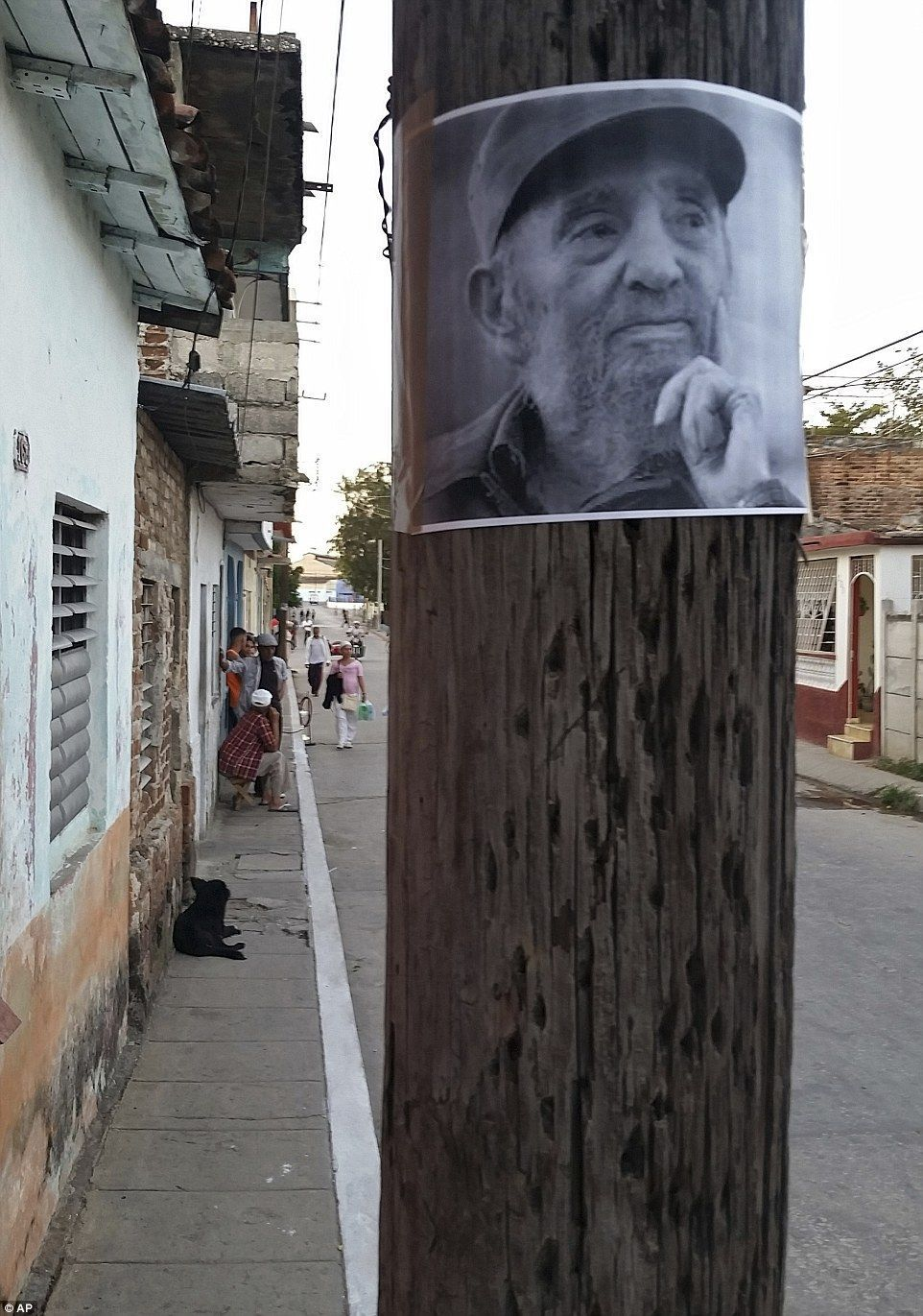 Thousands of Cubans line the streets for Castro's ashes final journey #cubanleader An image of the late Cuban leader Fidel Castro is taped to a wooden pole in downtown Santa Clara on Wednesday, before his ashes arrived in the town #cubanleader Thousands of Cubans line the streets for Castro's ashes final journey #cubanleader An image of the late Cuban leader Fidel Castro is taped to a wooden pole in downtown Santa Clara on Wednesday, before his ashes arrived in the town #cubanleader