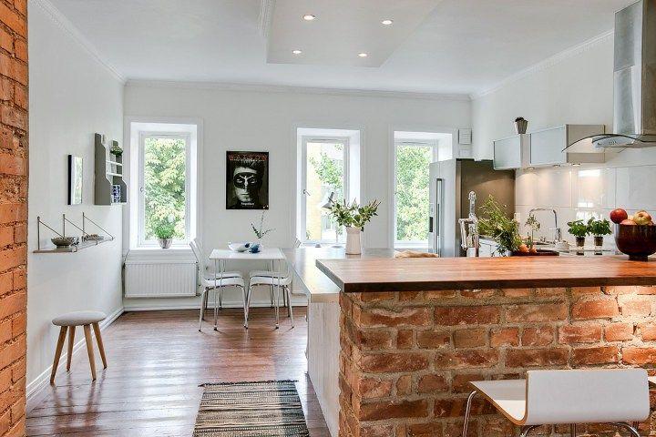 Ladrillo visto, vigas de madera y panelados Interiors