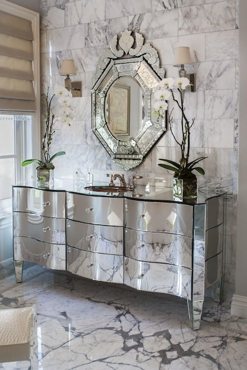 Exquisite Bathroom With Large Statuary Marble Subway Tiled Wall Framing Venetian Mirror Over Mirrored Washstand Accented