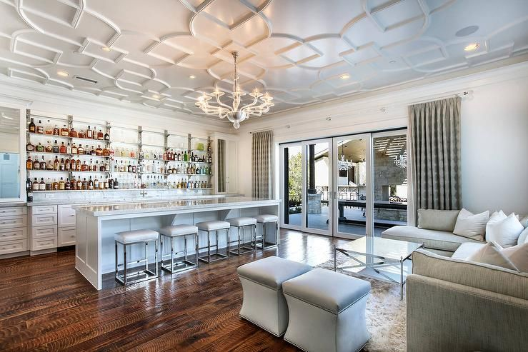Chic Contemporary Living Room Wet Bar Stands Out With Geometric Overlay Ceiling Panels Holding A White Gl Modern Home Bar Home Bar Accessories Home Bar Designs