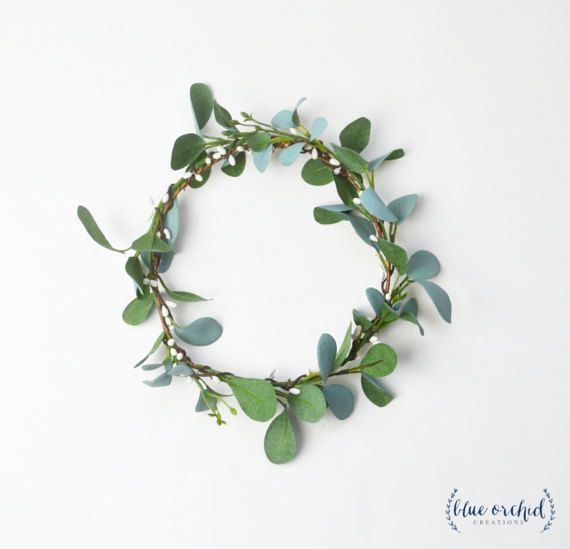 This beautiful, flower crown is filled with greenery and white berries. The base of the crown is wrapped entirely with cream/white, faux berries and gorgeous, green eucalyptus that has a slight blueish tint on one side of each leaf. This eucalytpus crown, is the perfect greenery crown for your wedding or photo shoot! Look through our shop and social media profiles to see how brides have styled our silk, flower crowns! Flower selection and color, as well as stem wrap selection and color,...