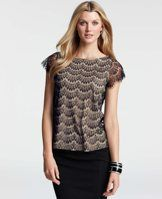 Lace Short Sleeve Tee - Edge meets elegance in this intricate stunner, flaunting a lovely lace overlay and sheer sleeves with raw scalloped edges for a couture worthy finish. Jewel neck. Short sleeves.