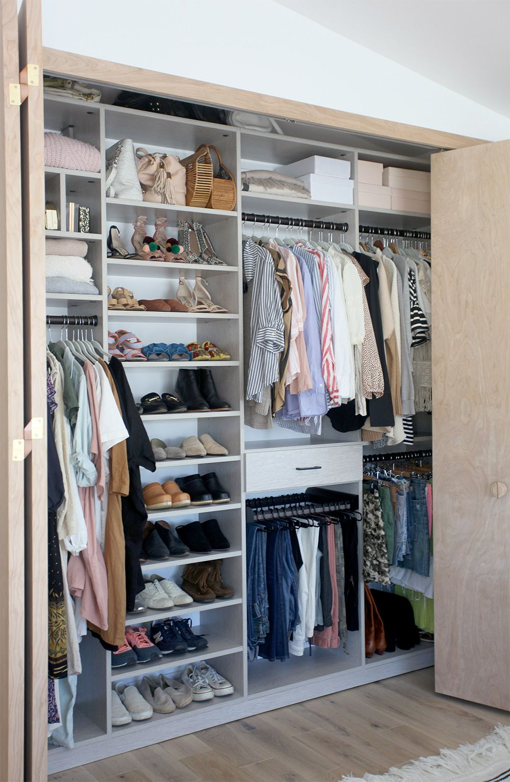 Lovely Custom Reach In Closet With Multiple Hanging Areas And