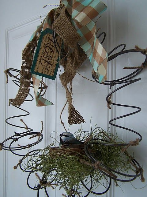 """Photo of Primitive """"SPRING"""" Wreath…made from old bed springs…with a nest & a bird."""