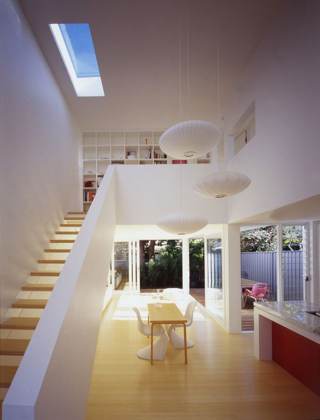 this is the ultimate mix for me: staircase, bookcase, skylight, lamps, windows.