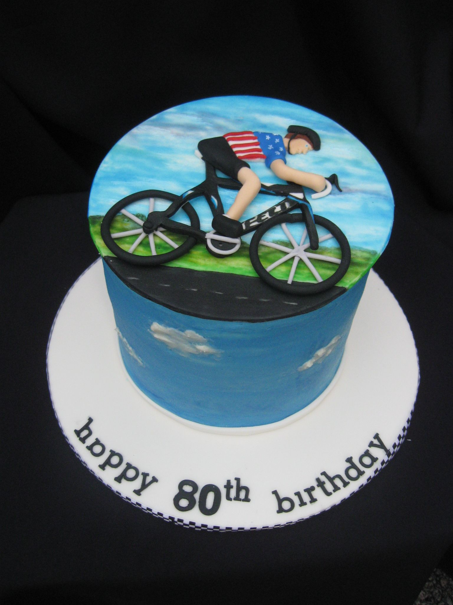 cyclist cake fondant top bike and man painted with gel color