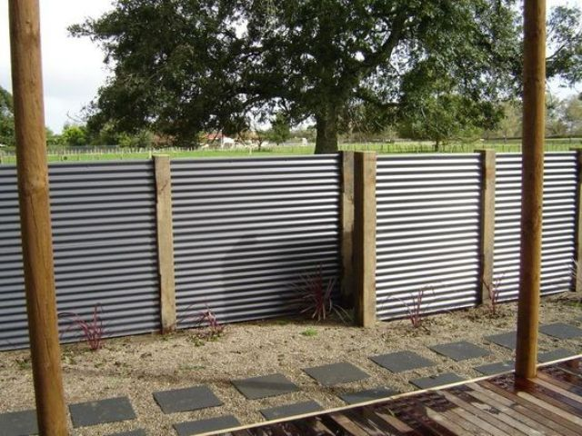 Corrugated Metal Sheet Fence With Wooden Posts Outdoors