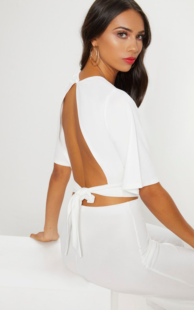 3bc61cad1d0 White Crepe Tie Back Crop Top. Shop the range of tops today at  PrettyLittleThing. Express delivery available. Order now