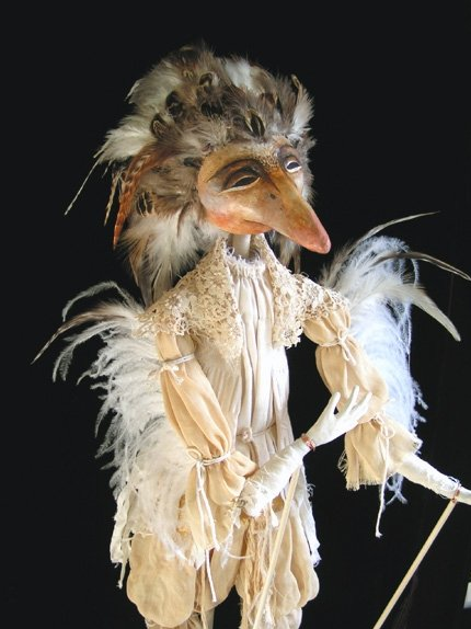 A rod puppet is a puppet constructed around a central rod secured to the head. A large glove covers the rod and is attached to the neck of the puppet.