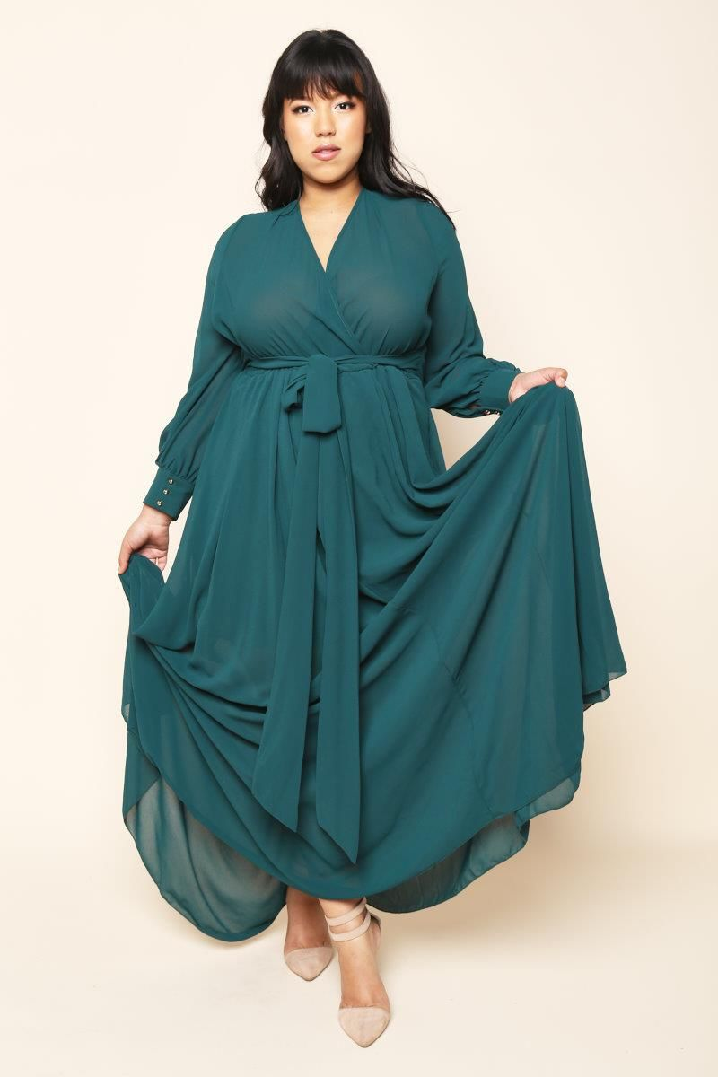 A plus size maxi surplice dress with a wrapped vneckline and long