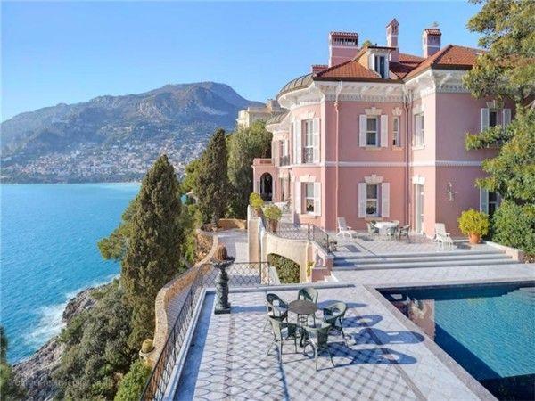 The Belle Epoque Villa Les Rochers in Roquebrune-Cap-Martin on the Cote d'Azur awash in the region's favorite pink.