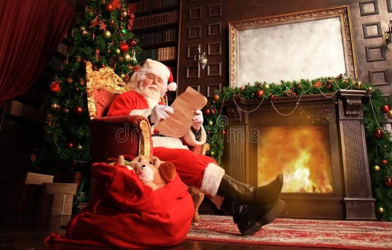 Portrait Of Happy Santa Claus Sitting At His Room At Home Near Christmas Tree An Sponsored Claus Sit Christmas Lettering Christmas Sofa Christmas Images
