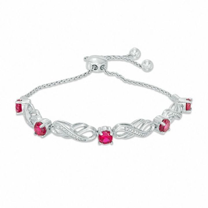 Zales Lab-Created Ruby and 1/20 CT. T.w. Diamond Infinity Bracelet in Sterling Silver - 7.5 pQZoGMPy