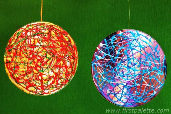 Kids Craft Ornaments From Puffy Paint And Old Cds Possible Christmas Party Christmas Tree Ornament Crafts Kids Christmas Ornaments Christmas Ornament Crafts