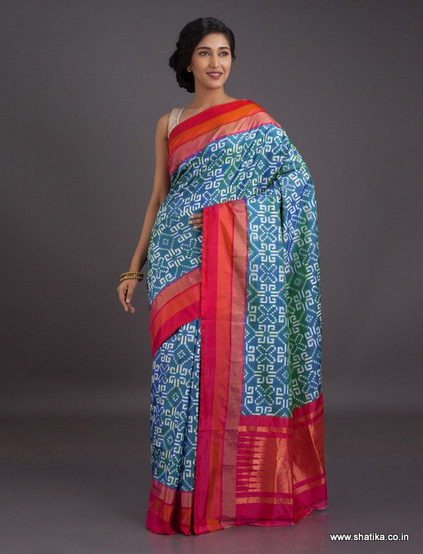 94d22fef32 The white rangoli design thrown on a blue background, this ikat Pochampally  saree is a representation of Andhra's rich cultural heritage.