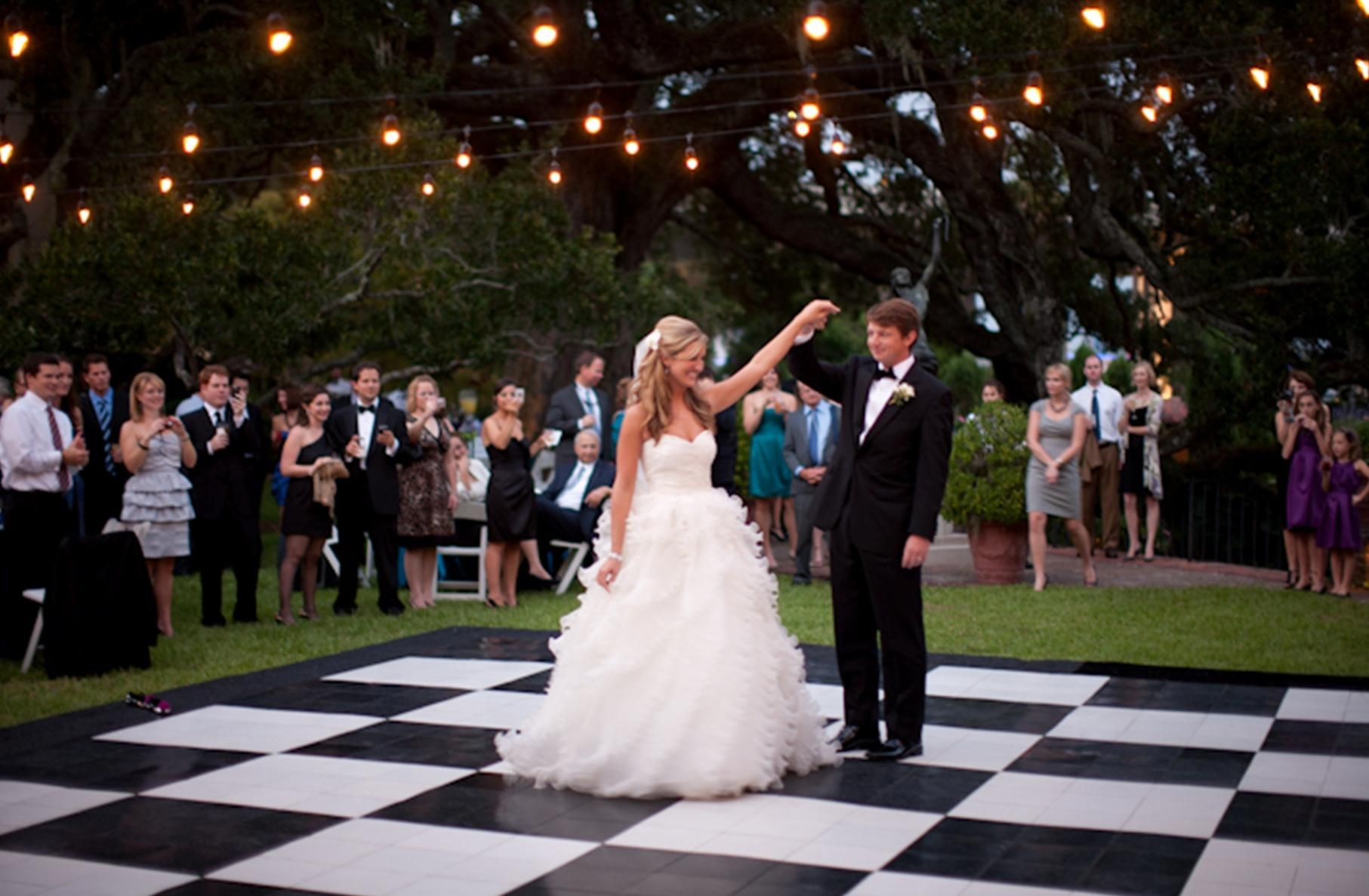 Big Checkered Dance Floor Outdoors With Lanterns