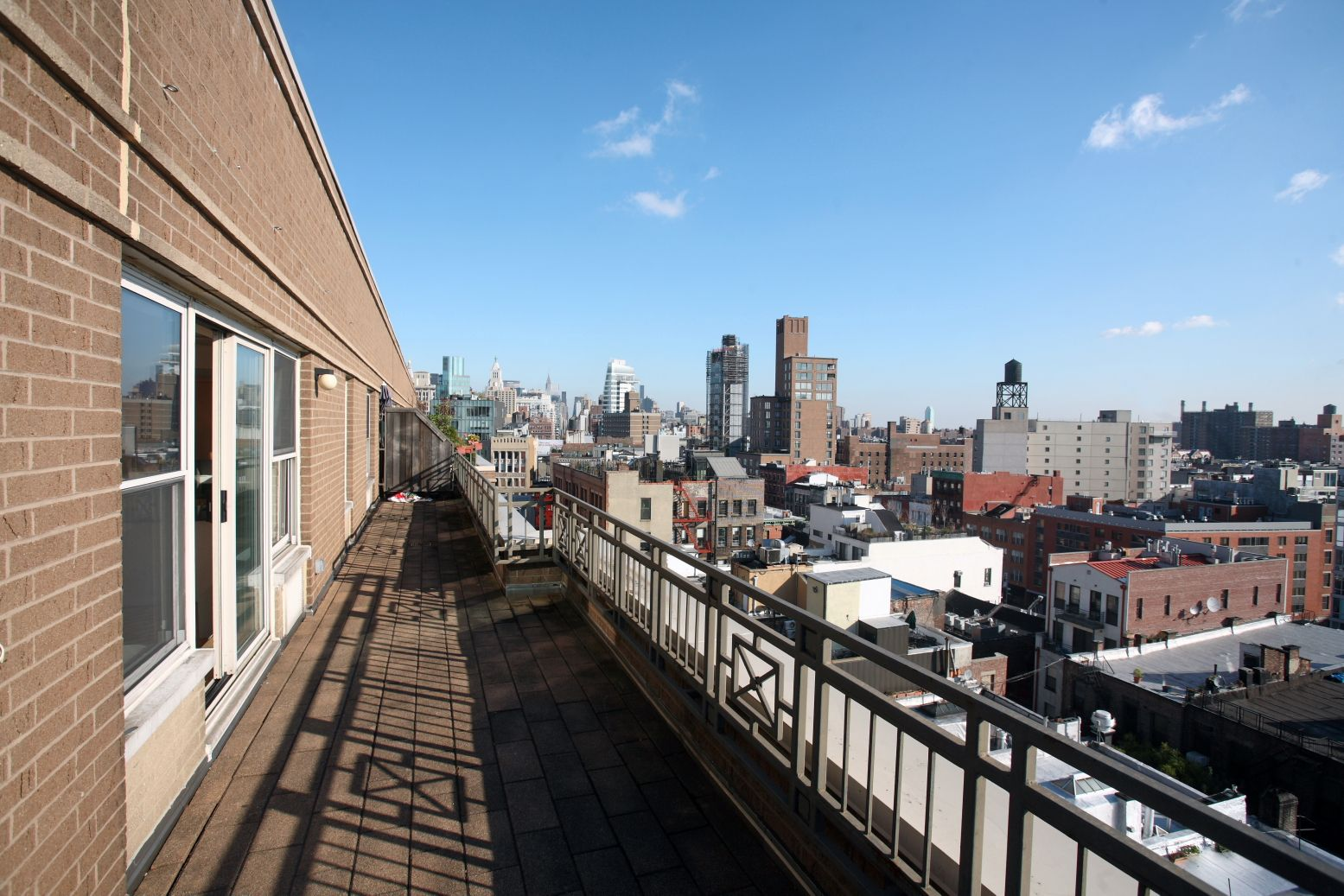 apartment terrace view of manhattan from the soho court luxury