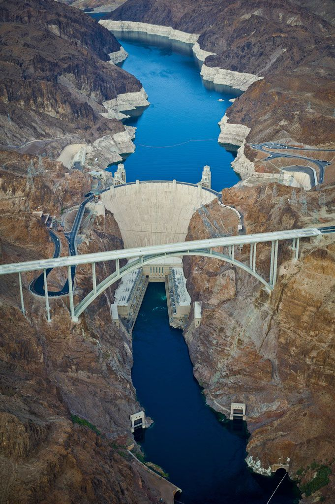 Hoover Dam....awesome picture with the new bridge...cannot believe how much the lake has dropped, you can tell by the white along the sides of the stone/rocks.