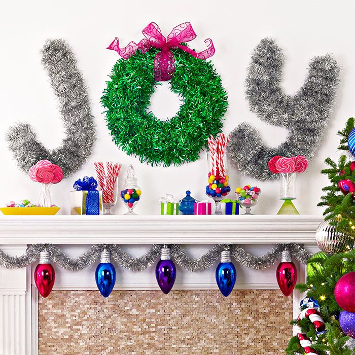 Christmas Fireplace Decorations Include Joy Spelled Out By A Wreath And Garland Wrapped Cardb Christmas Tinsel Christmas Wall Decor Christmas Fireplace Decor