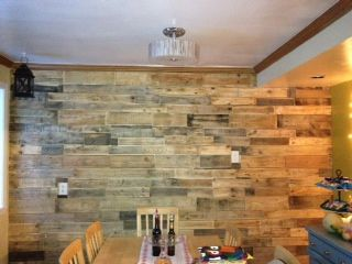 Pallet wall: I got all of the wood for this project for free! I gathered up pallets from companies around town. I cut them to the sizes I wanted, sanded them down, and nailed them up to the wall randomly. It looks simply amazing and I love that it was entirely free! Took about three days from start to finish.
