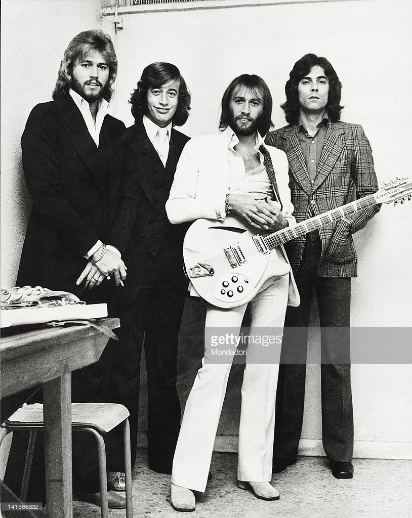 The Bee Gees Musical Group Posing With A Guitar The Band Is Composed Bee Gees Bee Gees Photos Group Pose