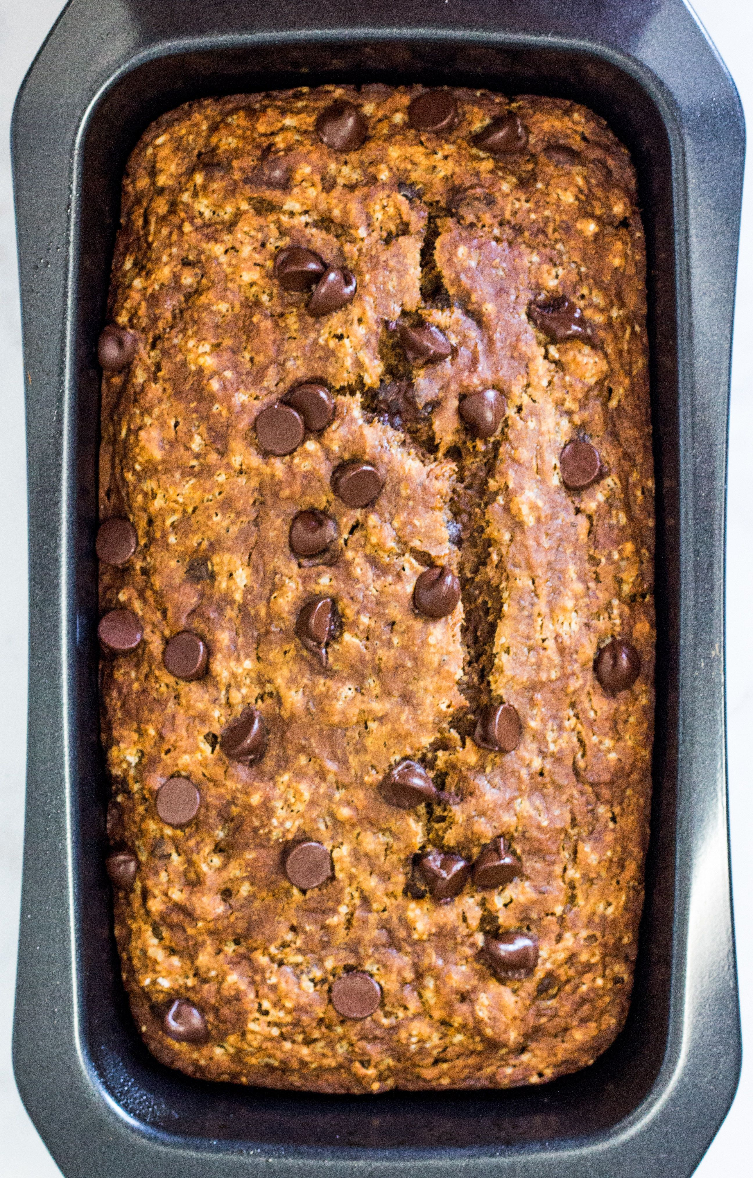 Moist and fluffy Gluten Free #Vegan Banana Bread with LOTS of Chocolate Chips. One bite of this soft and springy banana bread and you'd never guess it's #glutenfree #oilfree and #nutfree !!
