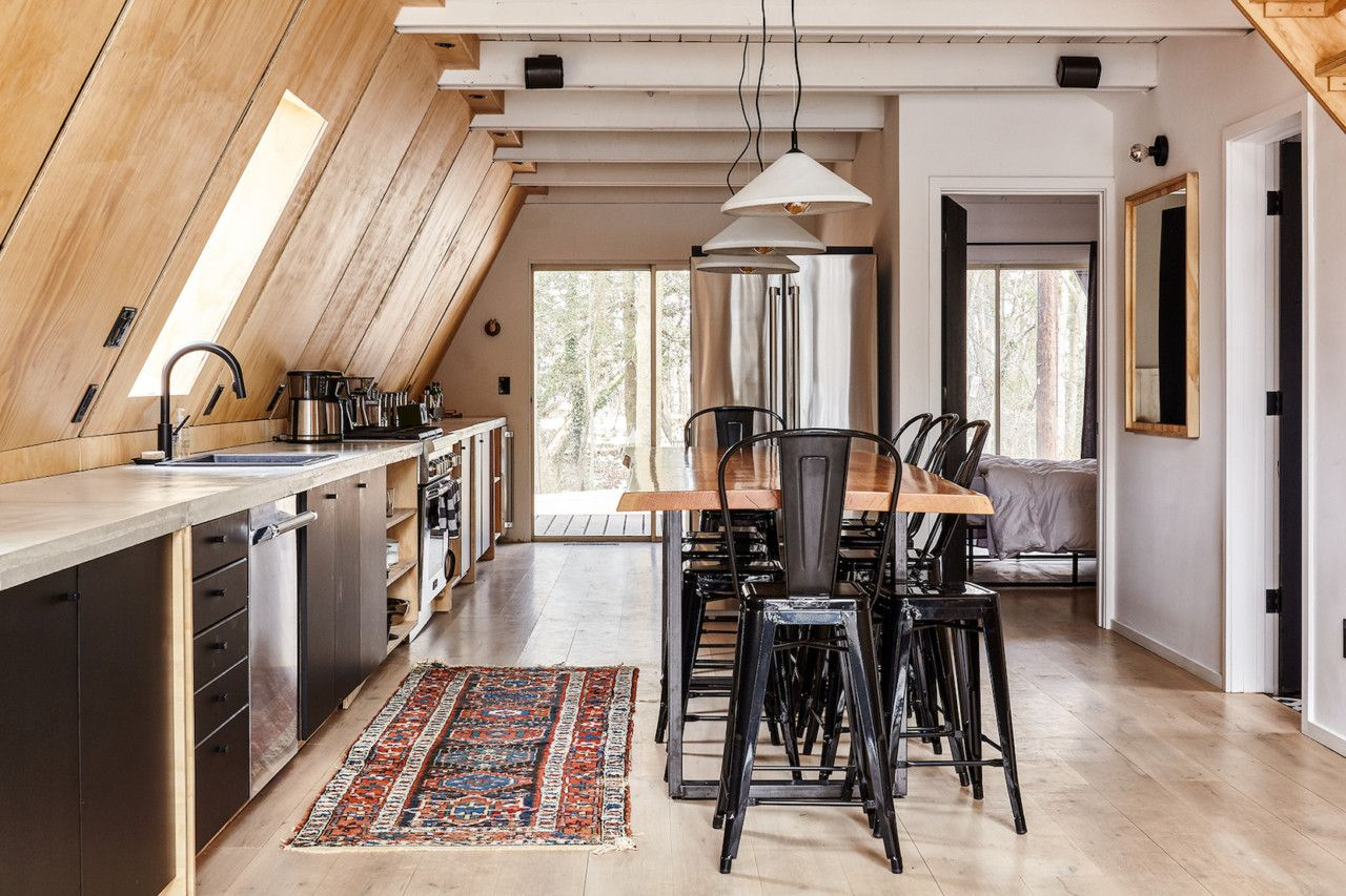 Take A Retreat To This Scandinavian Modern A Frame Cabin In The Middle Of The Woods A Frame Cabin A Frame House Cabin Interiors