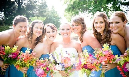 Love the loose look of the bouquets, though the colors might be a bit bright
