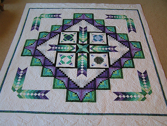 Create a Stunning Quilt That Shimmers with Color is part of Paper quilt, Cross quilt, Braid quilt, Quilts, Quilt patterns, Machine quilting - You'll be Proud to Call This Quilt Your Own! Intricate piecing and inspired color choices make this quilt one you'll be very proud to call your own  All the elements are simple to piece  Just be as accurate as possible so everything fits together nicely  The quilt is stunning in any closely coordinated color theme  …