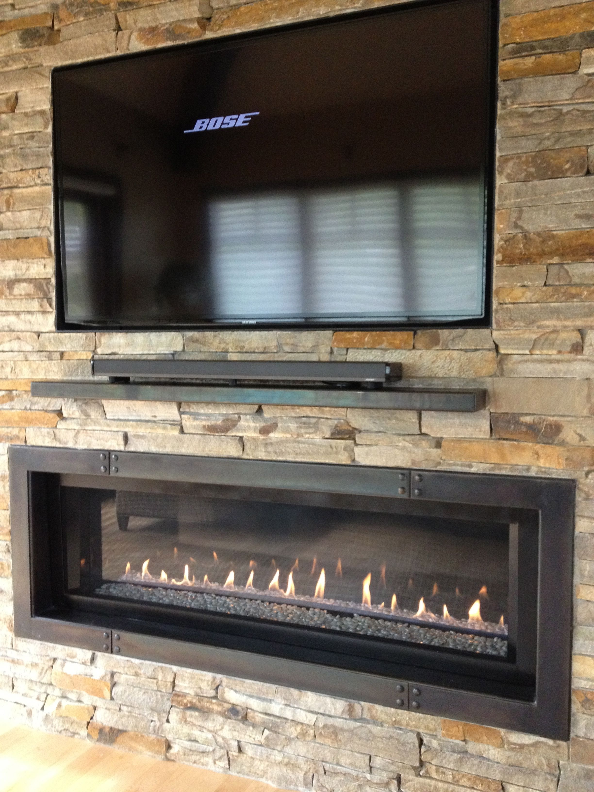 60 Tv With 5 Ribbon Fireplace Plus Custom Iron Surround And Mantel Indoor Fireplace Fireplace Tv Wall Fireplace Feature Wall