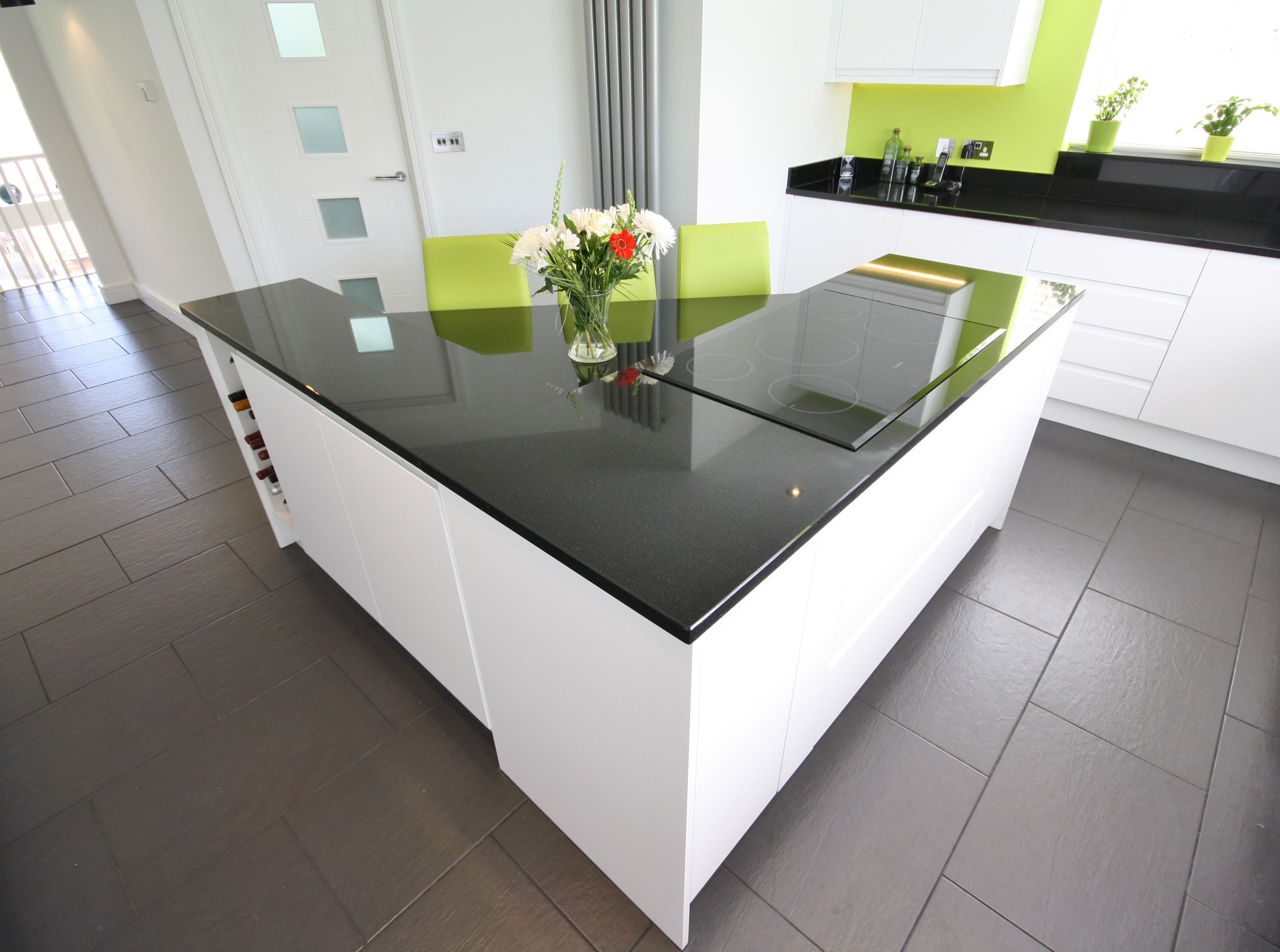 White Kitchen Units Black Worktop second nature - remo white gloss units, black granite worktop and