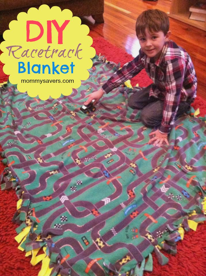 This DIY No-Sew Fleece Racetrack Blanket not only keeps you warm, it doubles as a speedway for your Matchbox and Hotwheels cars!