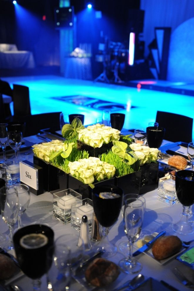 This is actually from a over the top bar mitzvah but its gorgeous modern black and white party decor sports theme soccer mitzvahs green flowers junglespirit