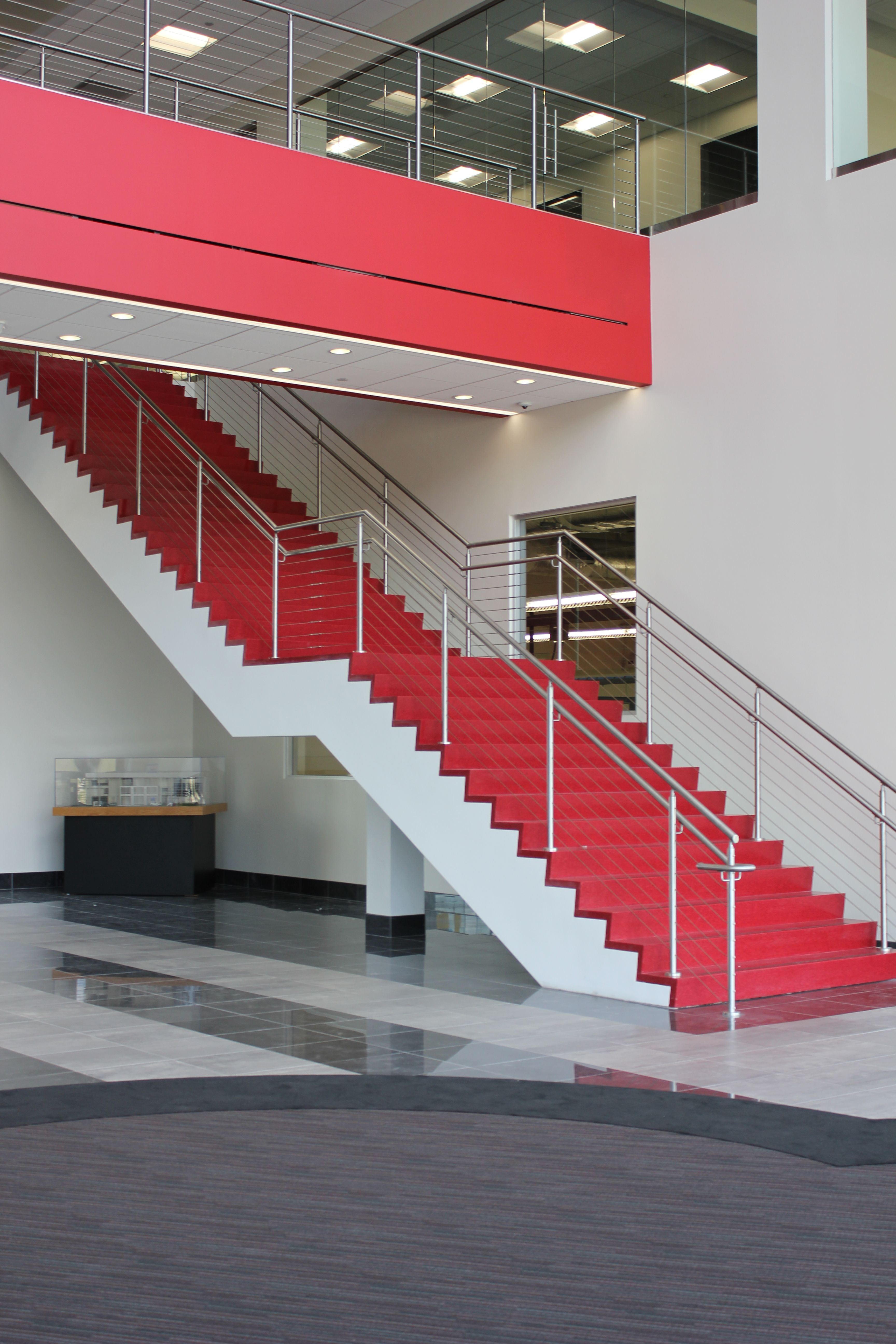 Lobby Monumental Stair Red Terrazzo Stainless Steel And Glass Railing