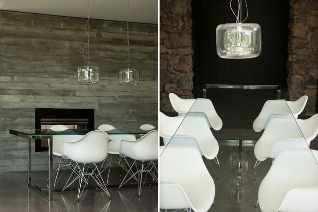 The fireplace is embedded within a concrete wall.